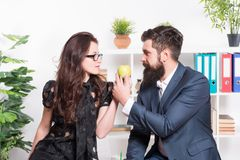Office lunch. Couple coworkers relax lunch break. Share lunch with with colleague. Flirting colleagues. Bearded man and. Office lunch. Couple coworkers relax royalty free stock images