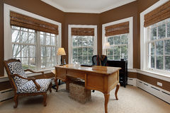 Office in luxury home. Surrounded by windows Royalty Free Stock Image