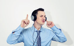 Office man listening to music on headphones Royalty Free Stock Images