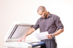 Office man making copies of documents Stock Photos