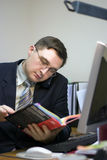 Office man is reading a book Royalty Free Stock Images