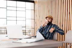 Office man relaxing with coffee cup on workplace