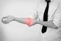 Office Man touching painful elbow Royalty Free Stock Photography