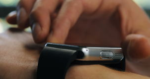 In office a man using his smartwatch. Extreme close-up hands digital device technology stock footage