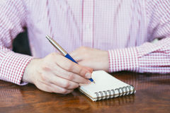 Office man writing notes on block papers Royalty Free Stock Photo