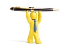 Office manager. Plasticine man hold over his head metallic pen stock photography