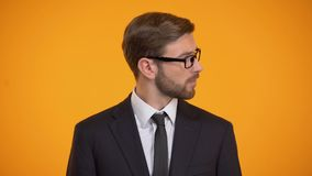 Office manager calling for employee, isolated on orange background, businessman. Stock footage stock video
