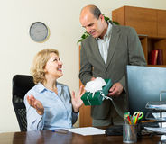 Office manager congratulating secretary Royalty Free Stock Photos