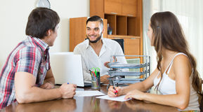 Office manager with couple signing contract Royalty Free Stock Image