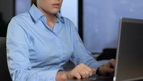 Office manager feeling tired of boring work tasks, typing on laptop, frustration. Stock footage stock footage
