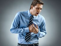 Office manager having heart attack. stock images