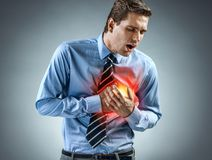 Office manager having heart attack. Medical concept royalty free stock photo