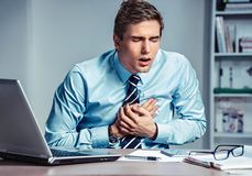Office manager having heart attack. Stock Photo