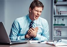Office manager having heart attack. royalty free stock image