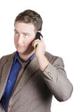 Office manager talking business on smartphone call Royalty Free Stock Image