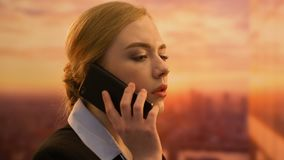 Office manager talking phone, booking flight tickets for boss business trip. Stock footage stock footage