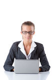 Office manager typing on the laptop isolated on Royalty Free Stock Photos