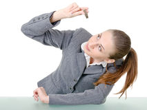 Office manager, a woman examining flash drive Royalty Free Stock Photo