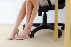 Office massage foot. Fatigue and relaxation. Office massage foot. Pain from high heels. Fatigue and relaxation Stock Image