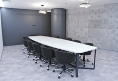 Office for meetings in the office. A large table for negotiations in the business center. A room for negotiations in the office of. The company stock photography