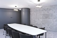 Office for meetings in the office. A large table for negotiations in the business center. A room for negotiations in the office of. The company royalty free stock images