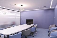 Office for meetings in the office. A large table for negotiations in the business center. A room for negotiations in the office of. The company royalty free stock photos