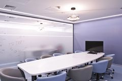 Office for meetings in the office. A large table for negotiations in the business center. A room for negotiations in the office of. The company royalty free stock image