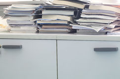 Office mess. Some documents and book in a office stock photography