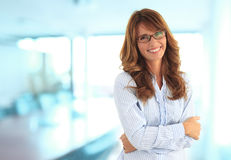 In the office. Modern business woman in the office with copy space Royalty Free Stock Images