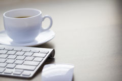 Office Morning Coffee and Modern Keyboard Background Royalty Free Stock Image