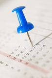 Office nail on the calendar Royalty Free Stock Photography