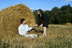 Office in nature. Teamwork at the field. two person and laptop Royalty Free Stock Image