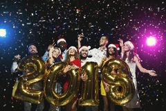 Office new year party. Young people having fun Stock Images