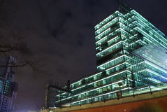Office night. Urban scene with an office building at night in Berlin, Germany Stock Photos
