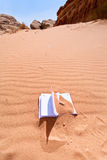 Office note book in red sand of desert Stock Photos