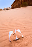 Office note book in red sand of desert Stock Photography