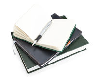 Office notepad and pen on top of the book. Stock Photo