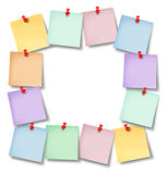 Office Notes Blank Frame. With several memos pinned to a white background wall with a red thumb tack in the shape of an empty square framed as a business Stock Photo