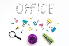 Office object. The word office, faded on a white background with metal stationery clips. The concept of office work. Set of office stationery. Office tools royalty free stock images