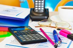 Office objects. Calculator and other various office objects on table. Shallow DOF effect Royalty Free Stock Image