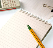 Office Objects. Notepad, pen and cellphone Royalty Free Stock Photo
