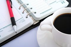 Office objects. Ever sharp pencil, notebook and black coffee Stock Images