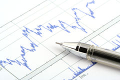 Office objects. Ballpoint pen on print chart Royalty Free Stock Photos