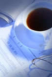 Office objects. Black coffee,glasses and newspaper on business file Royalty Free Stock Images
