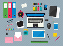 Office objects and business  documents. Flat multicolored design vector illustration of workplace with computer devices, office objects and business  documents Stock Photography