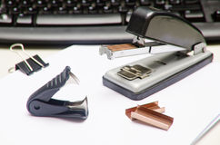 Office objects. Key borard and stapler Stock Image