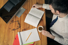 Office objects. Man on desk with office objects Royalty Free Stock Photo
