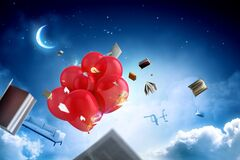 Office objects and red balloons flying in the sky