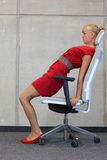Office occupational disease prevention. Gaining inner peace - business woman exercising on chair Stock Image