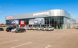Office of official dealer Toyota in sunny day. SAMARA, RUSSIA - MAY 14, 2016: Office of official dealer Toyota in sunny day. Toyota Motor Corporation is a Royalty Free Stock Photos